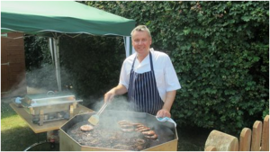 Celebrity Chef And Jigsaw Patron Tony Tobin Manning The Barbecue At The Recent Family Day, Where The Bake Off Was Launched