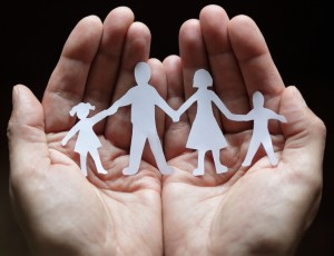 family and hands dark background